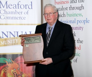 Albert McLean accepting the award for Farmer of the Year- Sponsored by Earth Power Tractors & Equipment