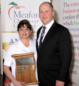 Nancy Ellis of Simply Unique Flowers & Gifts accepting the award for Business Owner of the Year- Sponsored by the BIA, presented by Chris Davies